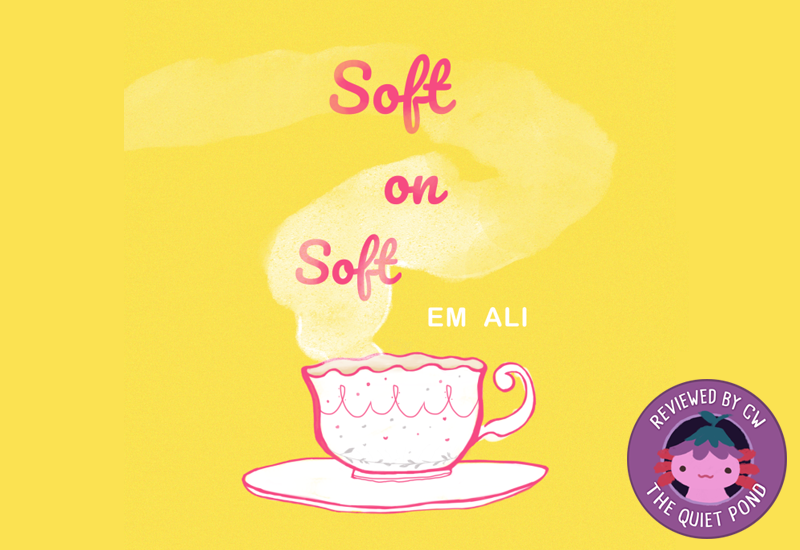 """TEXT: Soft on Soft, Em Ali. IMAGE: a white and pink cup, with steam rising above the text. Bottom right corner: Xiaolong the pink axolotl with an upside down flower hat at the center of a stamp, with the text """"Review by CW, The Quiet Pond"""" around it."""
