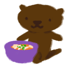 Party the stuffed otter, sitting up right with a bowl of soup in front of her.