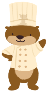 Cuddle the otter dressing up in a chef's costume, with Party the otter plushie sitting inside Cuddle's toque (chef's hat) - dressed up as Linguini from Disney's Ratatouille.
